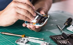 Man repairing broken smartphone, close up photo